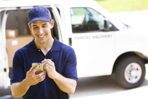 Royal_4_delivery_man_uses_handheld_for_signature