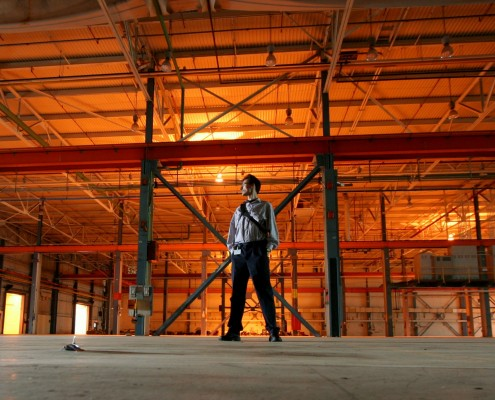 Royal_4_manager_looks_out_warehouse_door
